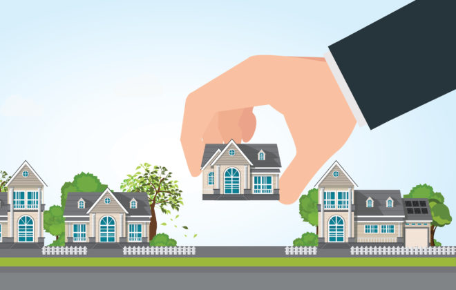 vaneck-housing-prices-Human hand select to holding a right house.